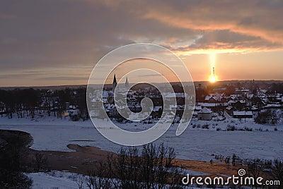 Natural phenomenon by sunset - light pillar (sun pillar or solar