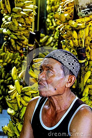 Free A Bananas Seller At Traditional Market. Royalty Free Stock Photos - 108965378