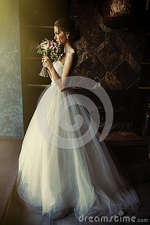 Free A Beautiful Bride Is Standing In A Room In The Window Of A Window Royalty Free Stock Images - 95611399