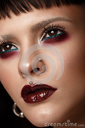Free A Beautiful Girl With Art Creative Make-up And Earrings On The Face. Stock Image - 108712851