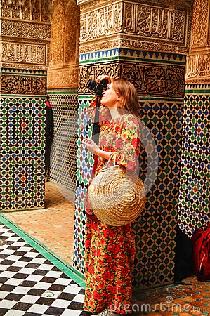 Free A Beautiful Russian Girl In A Bright Long Dress In The Palace Of Fes Takes Pictures Stock Image - 108747141