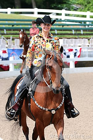 Free A Beautiful Smiling Senior Citizen Rides A Horse At The Germantown Charity Horse Show Stock Photos - 41366293