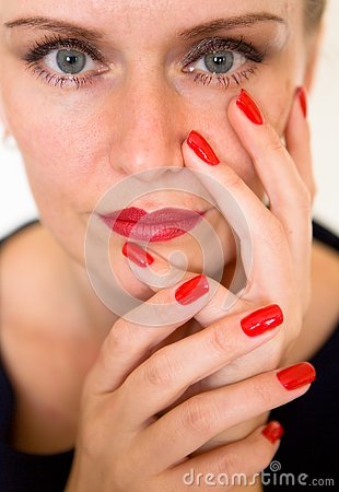Free A Beautiful Young Woman Is Touching Her Face With Her Fingers. Stock Image - 130964791