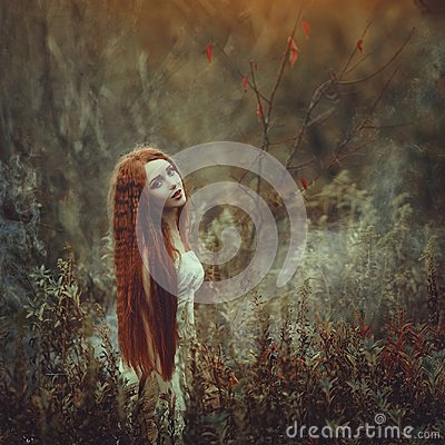 Free A Beautiful Young Woman With Very Long Red Hair As A Witch Walks Through The Autumn Forest. Stock Images - 102879634