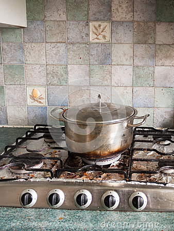 Free A Big Silver Metal Pan With Lid On And With A Burnt Black And Br Royalty Free Stock Image - 91012486
