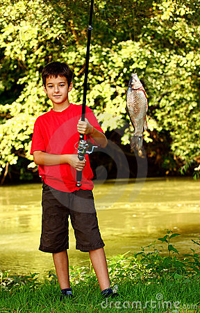 Free A Boy Catching A Fish Stock Photography - 20854482
