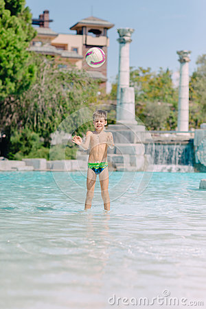 Free A Boy Plays With A Ball In The Water Royalty Free Stock Photos - 79971508