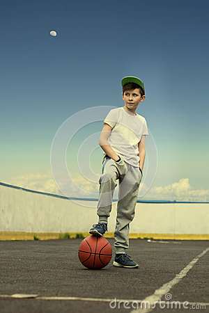Free A Boy With A Basketball Ball On The Background Of The Sky And The Moon. The Concept Of Sport Royalty Free Stock Image - 92662206
