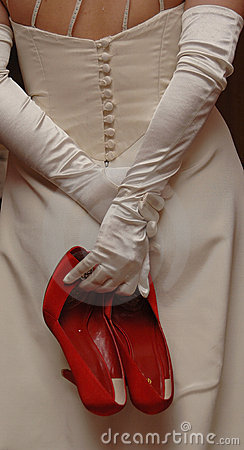 Free A Bride Holding Red Shoes Royalty Free Stock Photos - 1714068