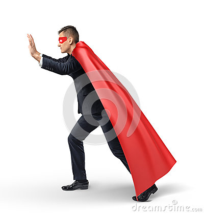 Free A Businessman In A Superhero Red Cape And An Eye Mask Pushing On An Invisible Object In Side View. Royalty Free Stock Photo - 90374815