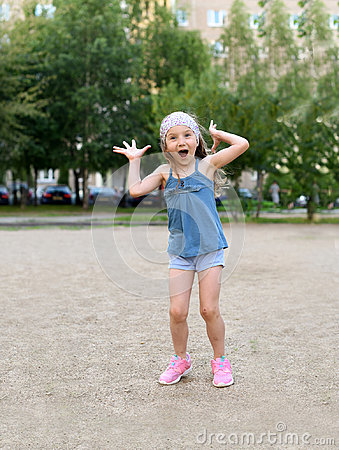 Free A Cute Little Girl Laughing And Making Faces Cute Little Girl Royalty Free Stock Images - 96449769