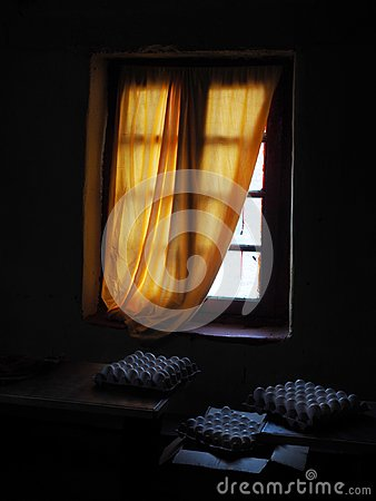 Free A Dark, Unlit Room, From A Single Window A Light Falls Through A Yellow Curtain, Near The Window Are Three Cells With Numerous Chi Stock Photo - 108992860
