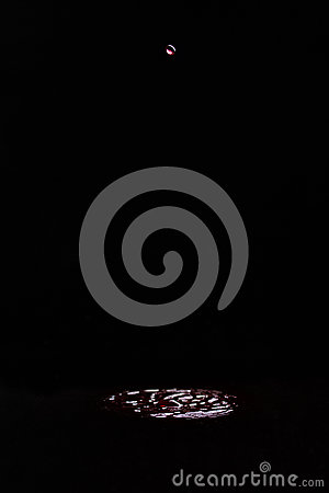 Free A Drop Of Red Wine Falling Into Wine On A Black Background. Splash, Circles On The Surface From The Fallen Drop. Stock Photos - 91769603