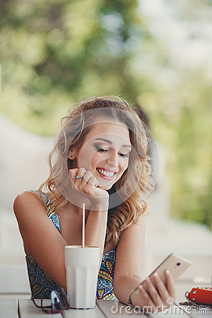 Free A Fun And Cheerful Model In A Summer Cafe. Royalty Free Stock Images - 62445999