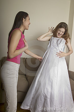 Free A Girl Shows Her Friend Her Wedding Dress Royalty Free Stock Photo - 279525