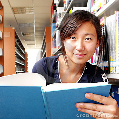 Free A Girl Sitting In Library Stock Image - 9716931