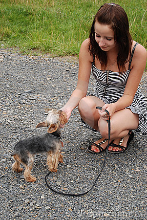 Free A Girl With A Dog Royalty Free Stock Image - 15803656