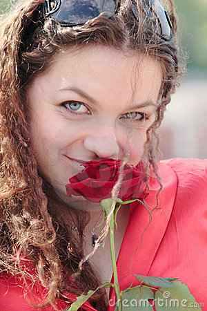 Free A Girl With A Smile And A Rose Royalty Free Stock Image - 14420856