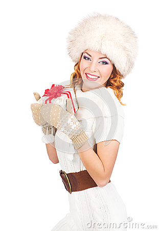 Free A Happy Woman In Winter Clothes Holding A Christmas Present Stock Image - 34792951