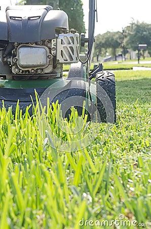 Free A Lawn Mower Cutting Summer Grass Stock Photos - 43367223