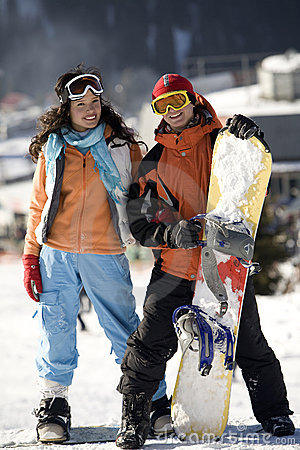 Free A Lifestyle Image Of Two Young Adult Snowboarders Stock Images - 10429304