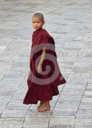 Free A Little Buddhist Monk In Maroon Robe Looking Deeply From Afar Royalty Free Stock Photography - 108418687