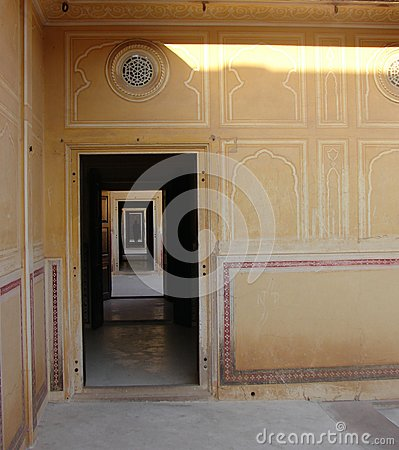 Free A Long Corridor Of Rectangular Doors With A Human Silhouette In Darkness Royalty Free Stock Photography - 118144997
