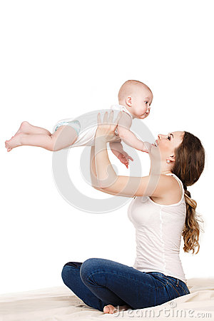 Free A Mother And Child Play Beds In The Bedroom. Stock Image - 51923111