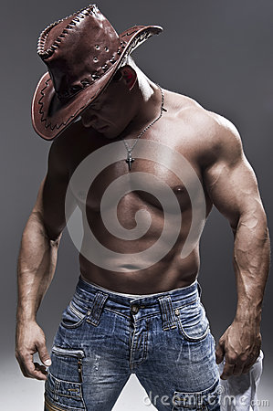 Free A Muscular Man In A Cowboy Hat Stock Photography - 28511292
