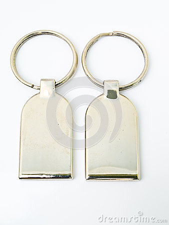 Free A Pair Of Metalic Trinket Keychain Isolated On White Background Stock Photo - 29693630