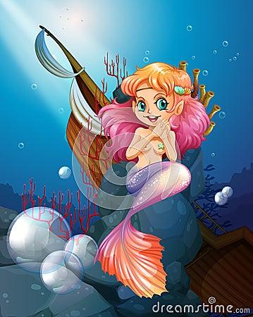 Free A Pretty Mermaid Under The Sea Near The Rocks Royalty Free Stock Photography - 40254087