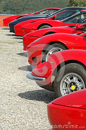 Free A Row Of Red Ferraris Royalty Free Stock Images - 47059919