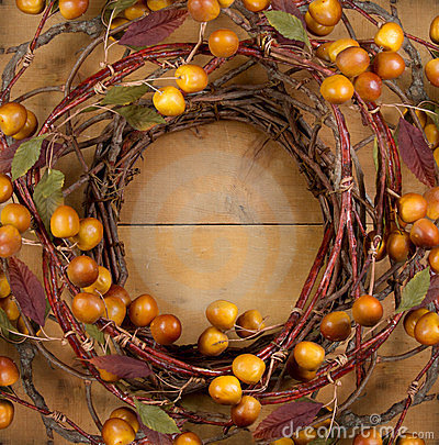 Free A Rustic Wreath On A Wooden Background Royalty Free Stock Photography - 23749277