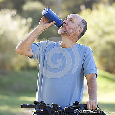 Free A Senior Man Cycling Royalty Free Stock Image - 67244806