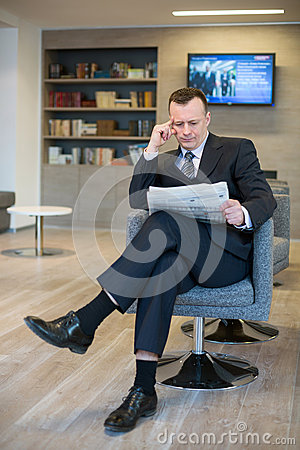 Free A Serious Businessman Reading A Newspaper Stock Photos - 32655563