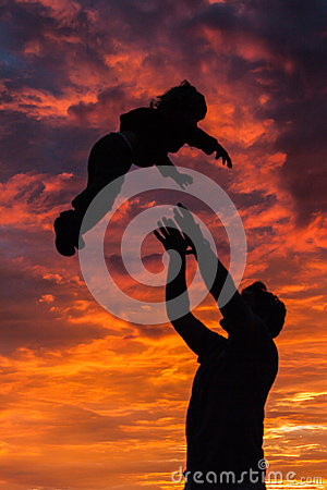 Free A Silhouette Of A Father Playing With His Son In The Setting Sun. Royalty Free Stock Photos - 68778548