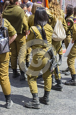 Free A Small Group Of Off Duty Female Israeli Army Conscripts With An Armed Guard Laugh And Chat Together At The Mahane Yehuda Street M Stock Photos - 119922243