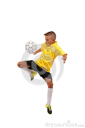 Free A Sportive Boy Kicking A Soccer Ball. A Little Kid In A Football Uniform Isolated On A White Background. Sports Concept. Stock Photos - 98089903