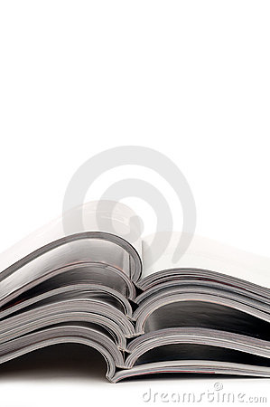 Free A Stack Of Open Magazines Stock Photos - 13725983