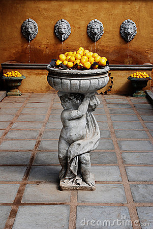 Free A Statue Of A Boy Holding Lemons. Royalty Free Stock Photo - 1899635