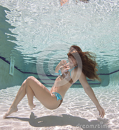 Free A Woman Wearing A Black Swimsuit Underwater. Royalty Free Stock Images - 99109409