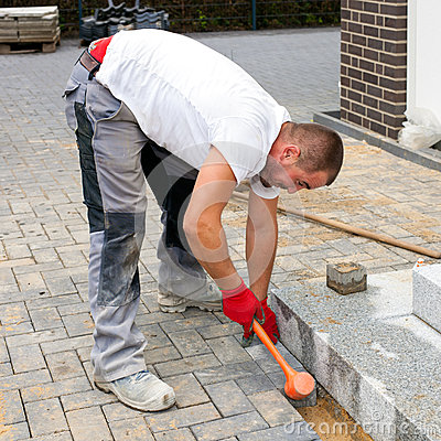 Free A Worker Creates A Terrace Of Concrete Paving Stones. Royalty Free Stock Photo - 48944155