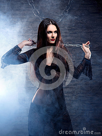 Free A Young And Witch In Dark Erotic Clothes Stock Images - 27034884