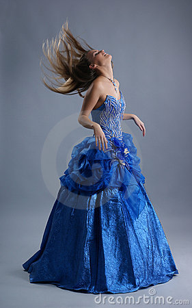 Free A Young Blond In A Blue Dress Is Shaking Her Hair Stock Image - 17758651