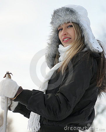 Free A Young Blond Woman With Ski In Winter Clothes Stock Image - 16847471