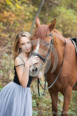 Free A Young, Blonde Girl Posing With A Horse, A Beautiful Girl And A Strong Horse. Royalty Free Stock Photography - 104669887