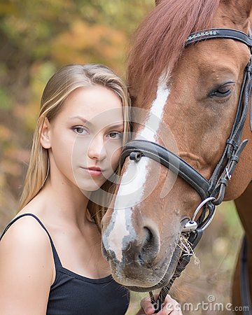 Free A Young, Blonde Girl Posing With A Horse, A Beautiful Girl And A Strong Horse. Stock Photos - 105215013