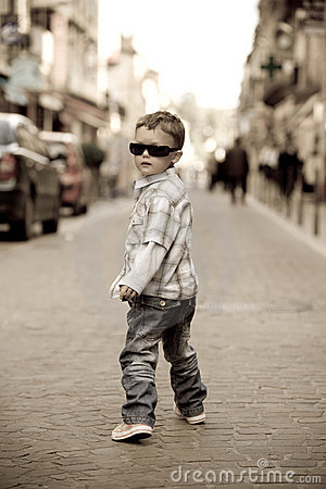 Free A Young Boy Struts His Stuff Royalty Free Stock Images - 13401389