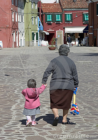 Free A Young Child And Her Grandmother Walk Along The Streets Of Bura Royalty Free Stock Image - 1065066