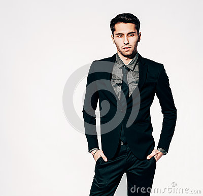 Free A Young Man In A Fashionable Suit Posing. Indoor. Warm Color. Stock Photography - 68122612